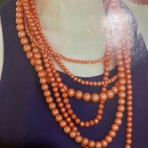 six strands necklace.
